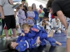 5x3.88    WVgames5      Arienna  Green, 10, of South Charleston takes down Ashton Francis, 9, of Morgantown during competition in Brazilian Jiu-Jitsu at Magic Island Saturday as part of the West Virginia Games.      Photo by chris dorst